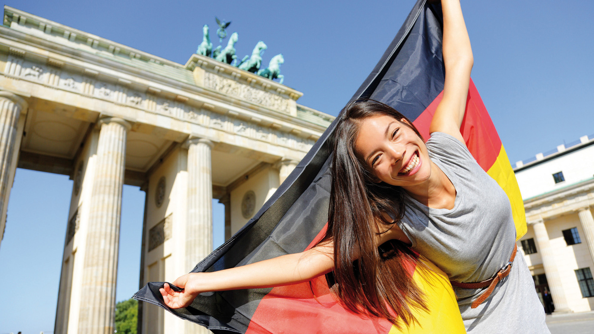 German flag woman happy at Berlin Germany