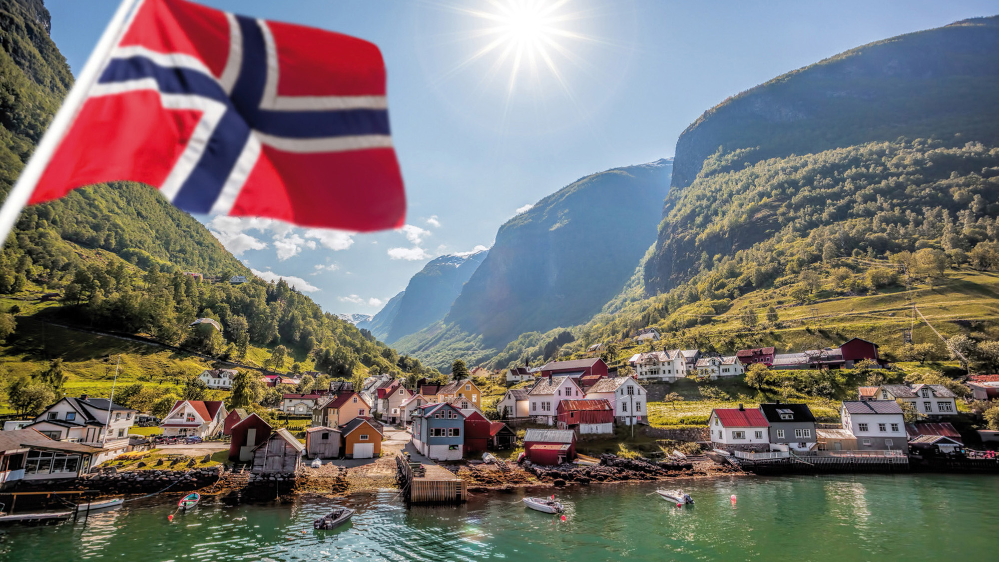Beautiful Fishing village Undredal against mountain near the Fla